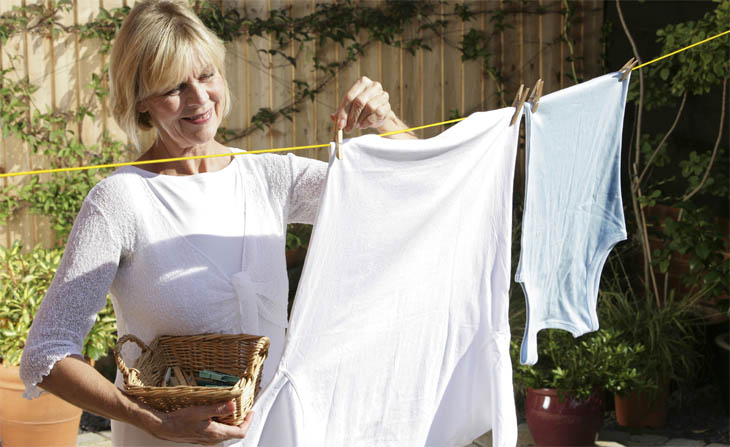 Lady Hanging Out Her Laundry To Dry